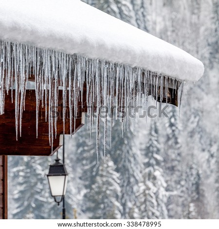 Icicles on roof Royalty-Free Stock Photo #338478995