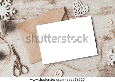 Stylish branding mockup to display your artworks. Cute vintage christmas new year gifts mock up on wooden background.