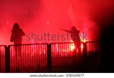 WARSAW, POLAND - NOVEMBER 11,2014 : The riots in the streets of Warsaw during the celebration of Independence Day on November 11, 2014 in Warsaw, Poland. #338569877
