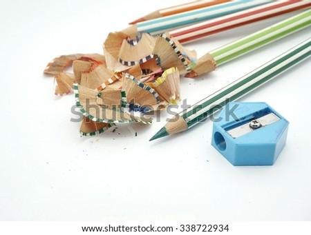 A green pencil color after sharpened and blue shapener on white background  #338722934