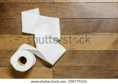 Toilet paper on wood background #338779226