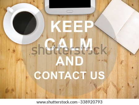 Keep calm and contact us with work table background