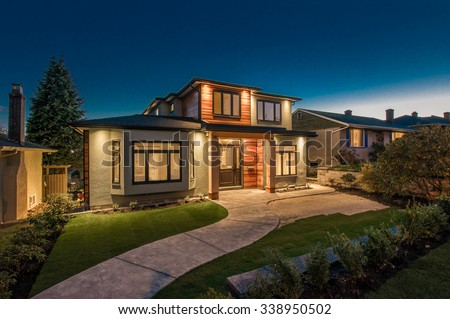 Big luxury, modern house at dusk, night time in suburbs of Vancouver, Canada. #338950502