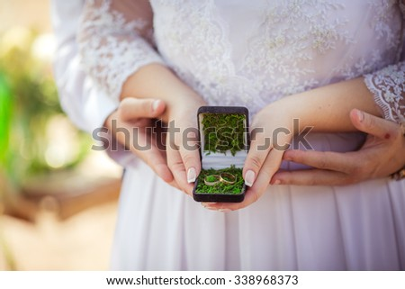 Wedding rings at bride's hands #338968373