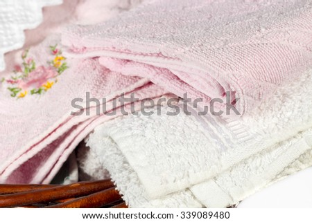 Detail of different hand towels on a wicker basket #339089480