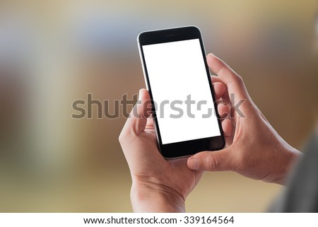 Male hand holding blank mobile smart phone. #339164564