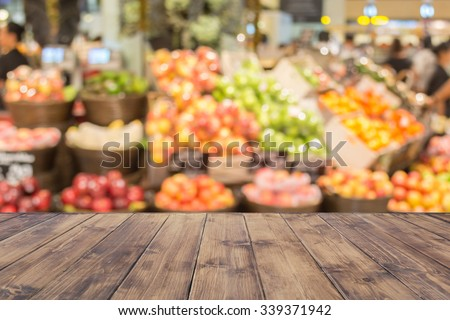 Empty wood table top on blurred market fruit. can montage or display your products #339371942