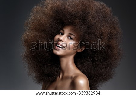 Beautiful Portrait of an African American Black Smiling Woman With Big Hair. #339382934