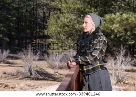 Young woman in nature wearing fall clothes  #339401246