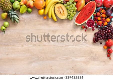 Healthy fruits background / studio photo of different fruits on wooden table #339432836