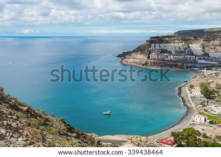 view of the beach del Cura Beach and Taurus in the municipality of Mogan, Gran Canaria, Spain Royalty-Free Stock Photo #339438464