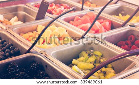 Toppings for frozen yogurt. Royalty-Free Stock Photo #339469061