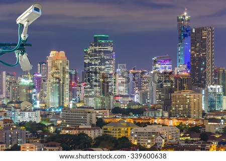 CCTV security on the building. Below is a view of the city lights at night time. #339600638