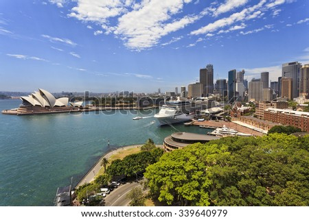 iconic landmarks of Sydney city - , circular quay, overseas passenger terminal,  summer day from elevated lookout on Harbour bridge Royalty-Free Stock Photo #339640979