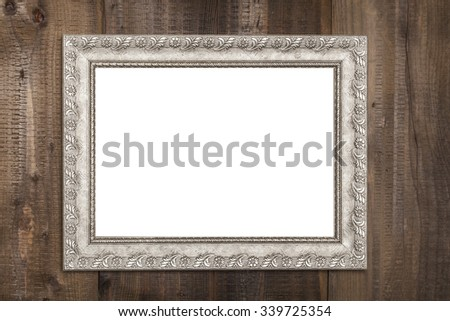 Horizontal Silver Empty Frame on Brown Wood Wall