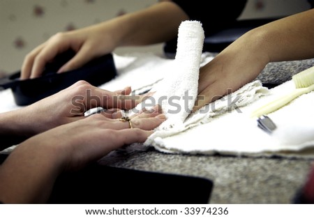 woman getting manicure #33974236