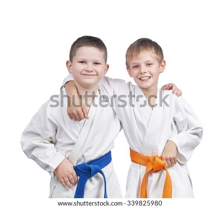 Athletes in a kimono and with different belts #339825980