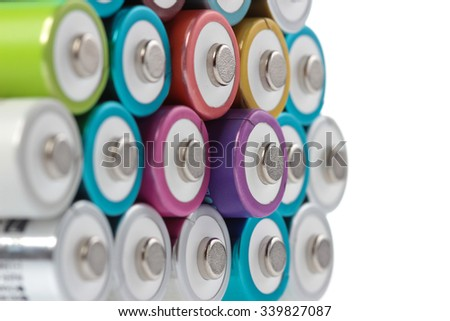 Several AA batteries in perspective closeup view on white background #339827087