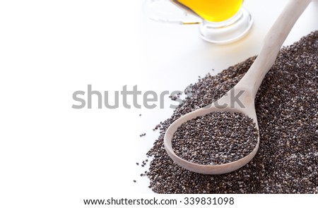 Dry chia seeds in spoon on Omega3 plant oil background #339831098