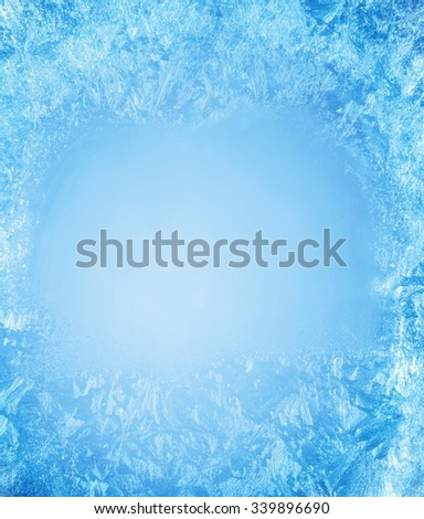 Frosty patterns on the edge of a frozen window. #339896690