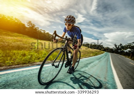 Woman Cycling outdoor exercise bike paths #339936293