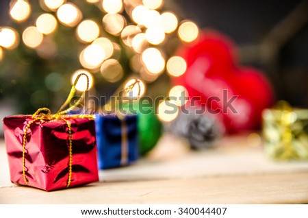 christmas gift box decor on light background process in coss color tone #340044407