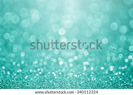 Abstract green teal or turquoise glitter sparkle background or aqua Christmas party invitation Royalty-Free Stock Photo #340112324