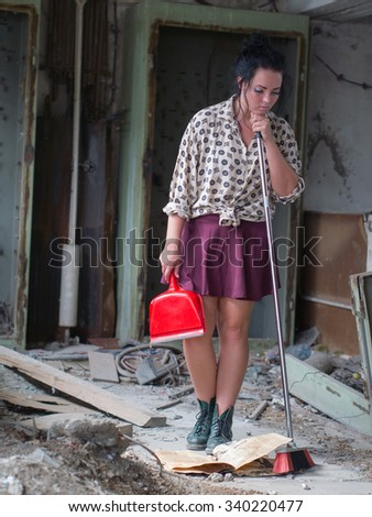 alone girl with broom in the dirty room #340220477
