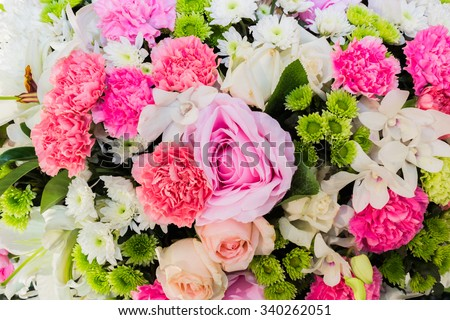Closeup view of one beautiful fresh bright white yellow big wedding bouquet of rose flowers, vertical picture