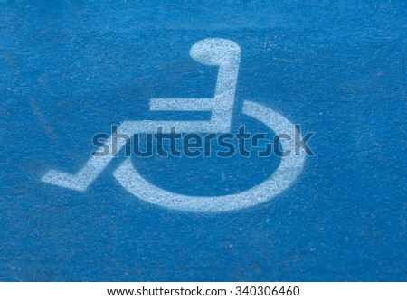 blurred disabled,handicap sign on blue floor #340306460