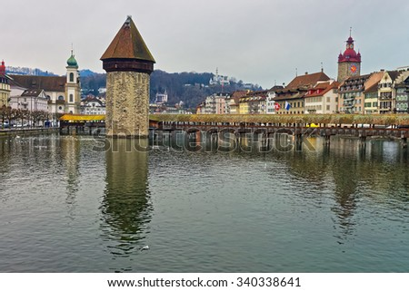Kapellbrucke or Chapel Bridge in Lucerne with its water tower seen in the middle. It serves as the citys symbol and as one of Switzerlands main tourist attractions #340338641