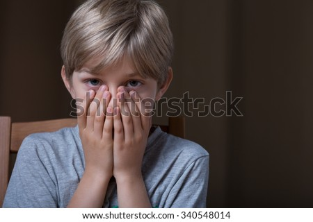 Afraid blonde young boy covering his mouth #340548014
