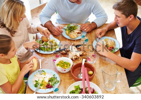 Overhead View Of Family Sitting At Table Enjoying Meal #340603892
