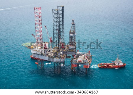 Offshore oil rig drilling platform with dingy light #340684169