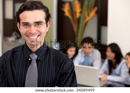 business man in an office leading a group #34089499