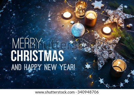 Christmas background with festive decoration  and text - Merry Christmas and Happy New Year.
