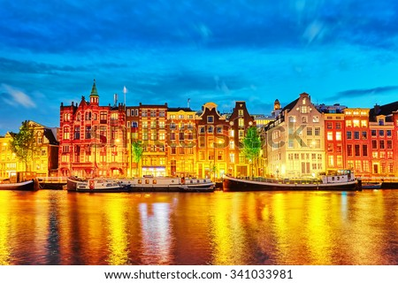Famous Amstel river and night view of beautiful Amsterdam city. Netherlands #341033981