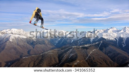 Flying snowboarder on mountains. Extreme winter sport #341065352
