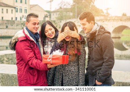 Image of woman guessing what present she is going to receive from her friends