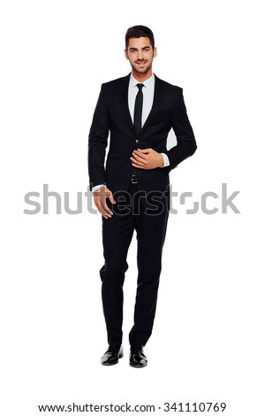 elegant businessman looking at camera with reliability isolated on white background Royalty-Free Stock Photo #341110769