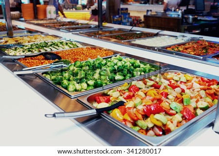 Vegetables and other foods in free-flo restaurant, toned image #341280017