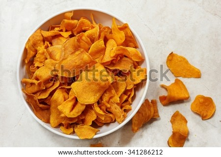 Baked sweet potatoes / Sweet potato chips, overhead view #341286212