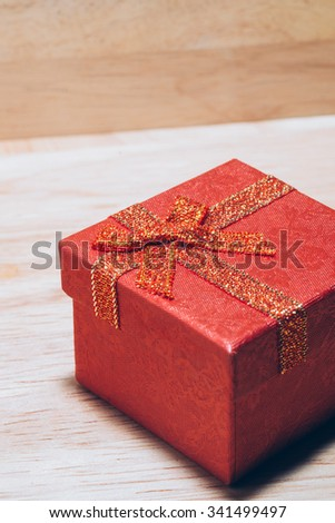 Christmas gift red box on wooden background #341499497