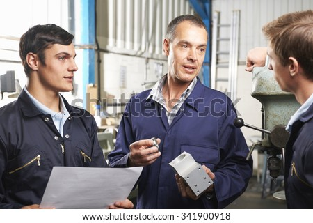 Team Of Engineers Having Discussion In Factory #341900918