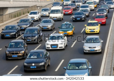modern city traffic jam in the rush hour??Fuzzy automotive background #342042533