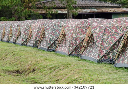 many camping tents on the lawn #342109721