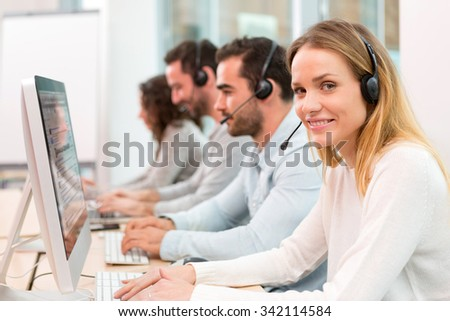 View of a Young attractive woman working in a call center #342114584