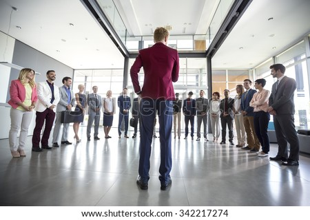 Business leader hold meeting with his team and tell them situation #342217274