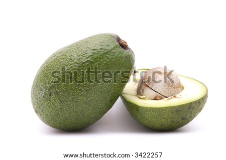 fresh, green avocado cut by half isolated on white #3422257