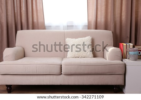 Comfortable sofa with pillows in the room, close up #342271109